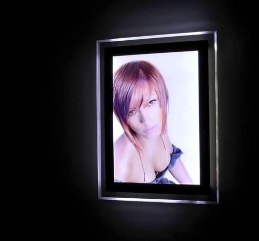Wall mounted illuminated display boards