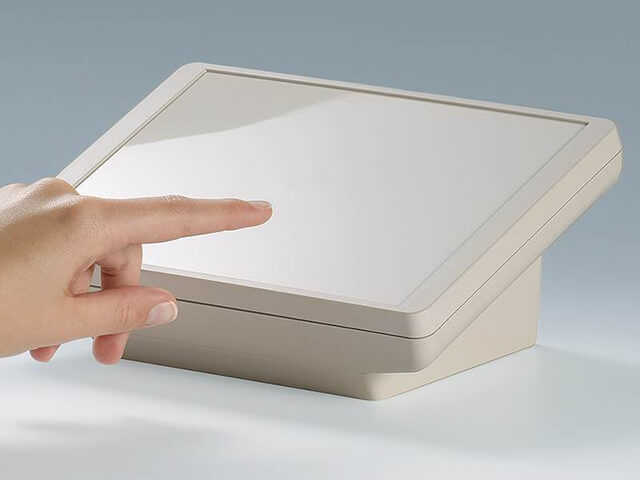 Sloping front desktop enclosures
