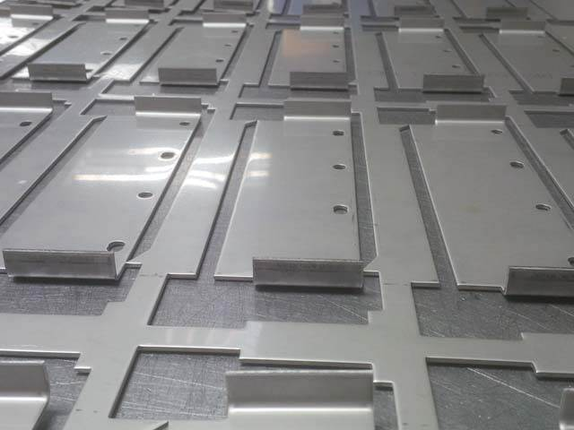 Steel sheet metal parts bent on a CNC punch press